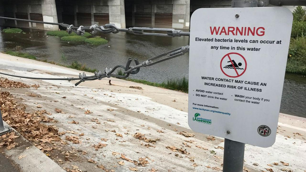 A sign warns Los Angeles River visitors of possible high levels of bacteria in the water.