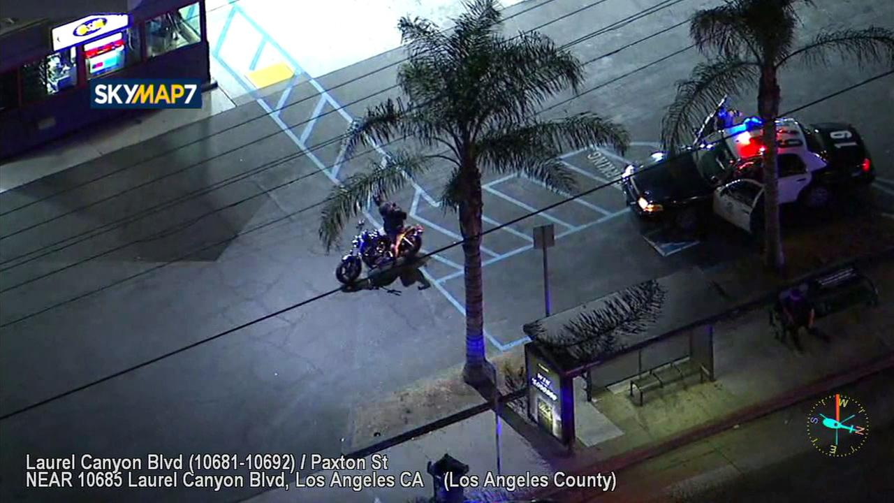 A man on a stolen motorcycle surrendered in Pacoima after leading police on a chase through the San Fernando Valley.