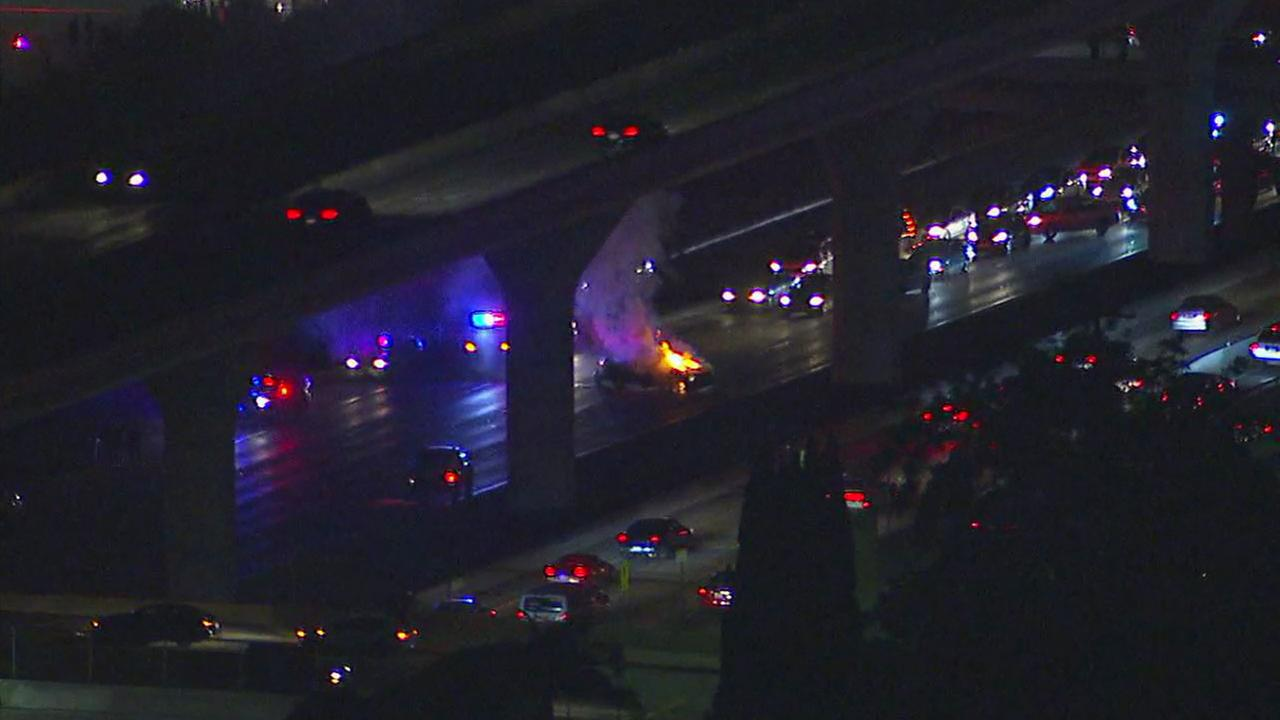A chase suspects vehicle erupted in flames on the northbound 110 Freeway in downtown Los Angeles after a car crash on Wednesday, Sept. 20, 2017.