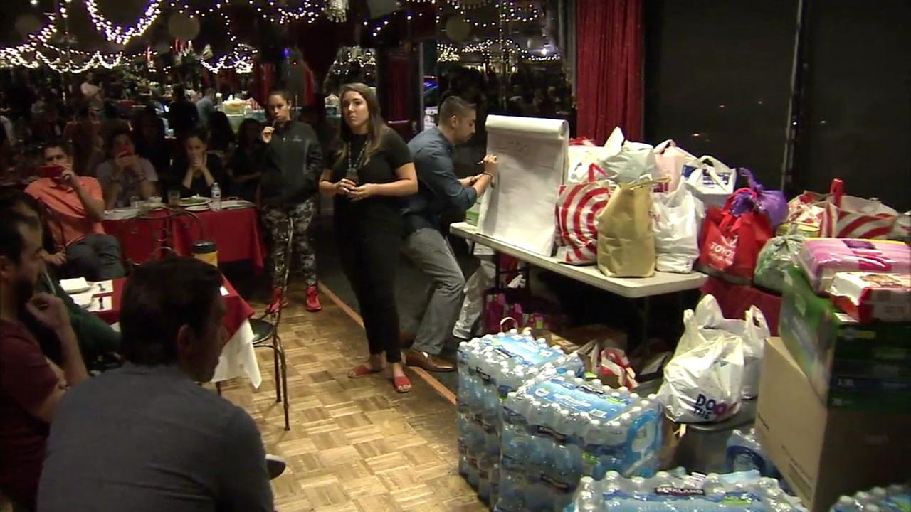 Members of the Los Angeles Puerto Rican community came together at El Floridita restaurant in Hollywood to gather donations for Hurricane Maria victims on Thursday, Sept. 21, 2017.