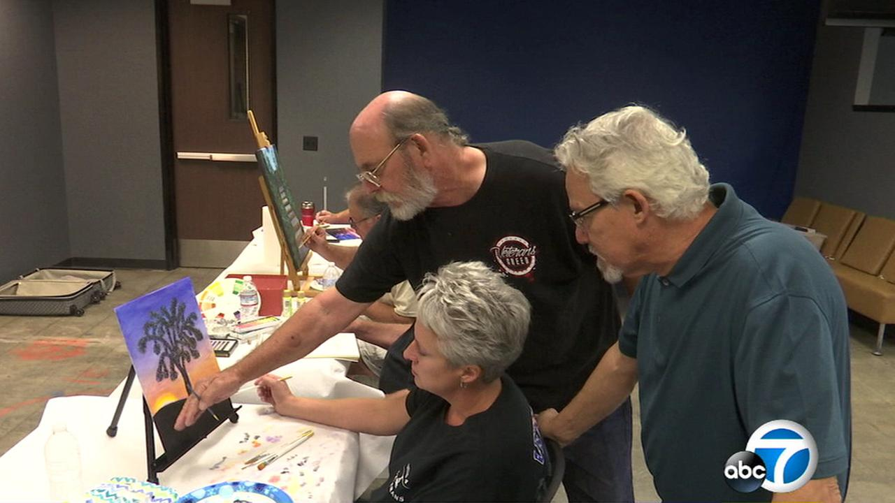 A group of military veterans who suffer from post-traumatic stress disorder have started a weekly art therapy group in Palmdale, where they gather to paint in a churchs basement.