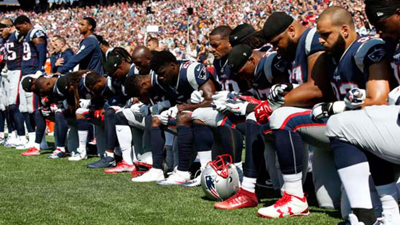Several New England Patriots players kneel during the national anthem before an NFL football game against the Houston Texans, Sunday, Sept. 24, 2017, in Foxborough, Mass.