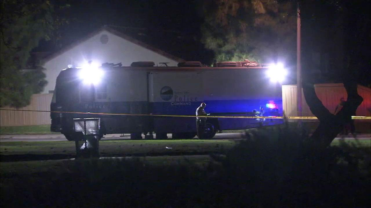 Authorities investigate the scene of a deadly shooting in Moreno Valley on Sunday, Sept. 24, 2017.