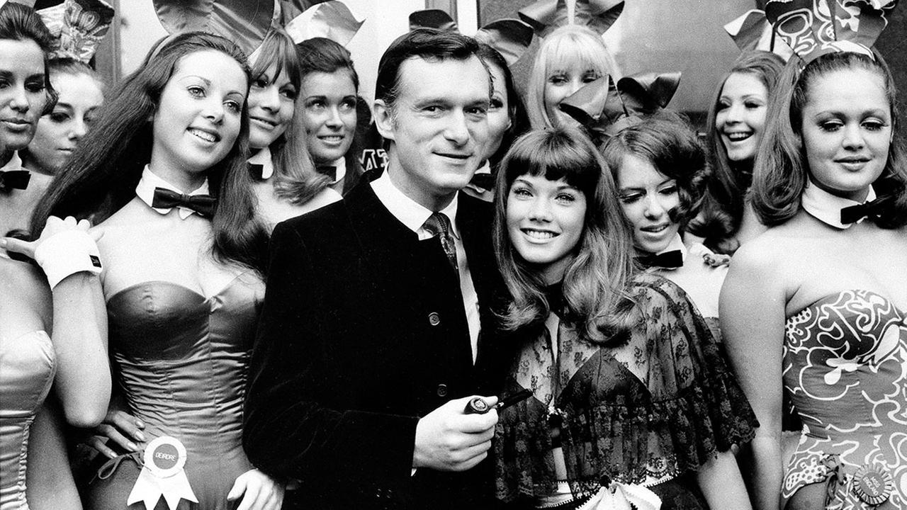 Hugh Hefner and his girlfriend Barbara Benton, 19-year-old coed turned actress, are surrounded by Bunny Girls at the Playboy Club in London on Sept. 5, 1969.
