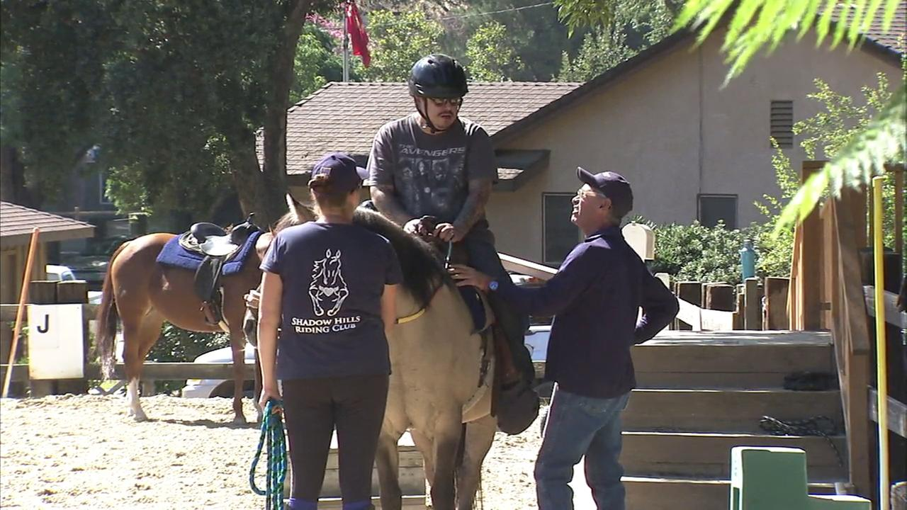 A therapeutic riding program is offered for military veterans at the Shadow Hills Riding Club in the San Fernando Valley.