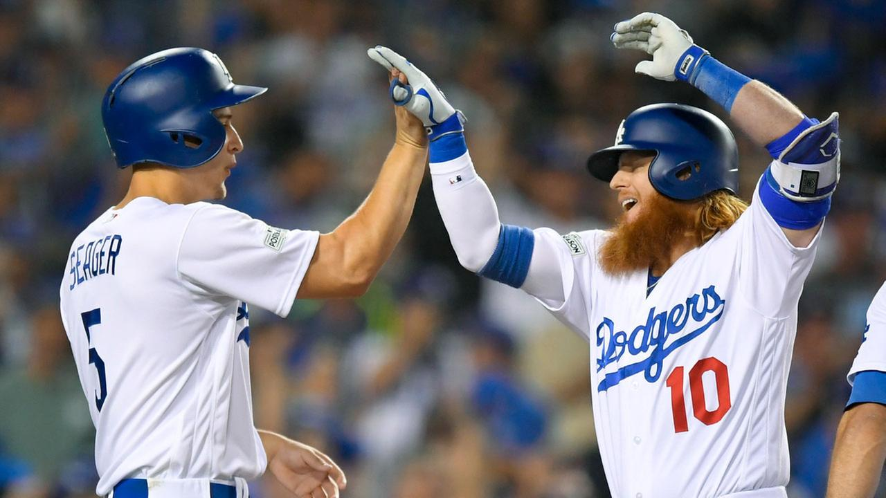 Los Angeles Dodgers Justin Turner, right, celebrates his three-run home run with Corey Seager during Game 1 of NLDS against the Arizona Diamondbacks on Friday, Oct. 6, 2017.