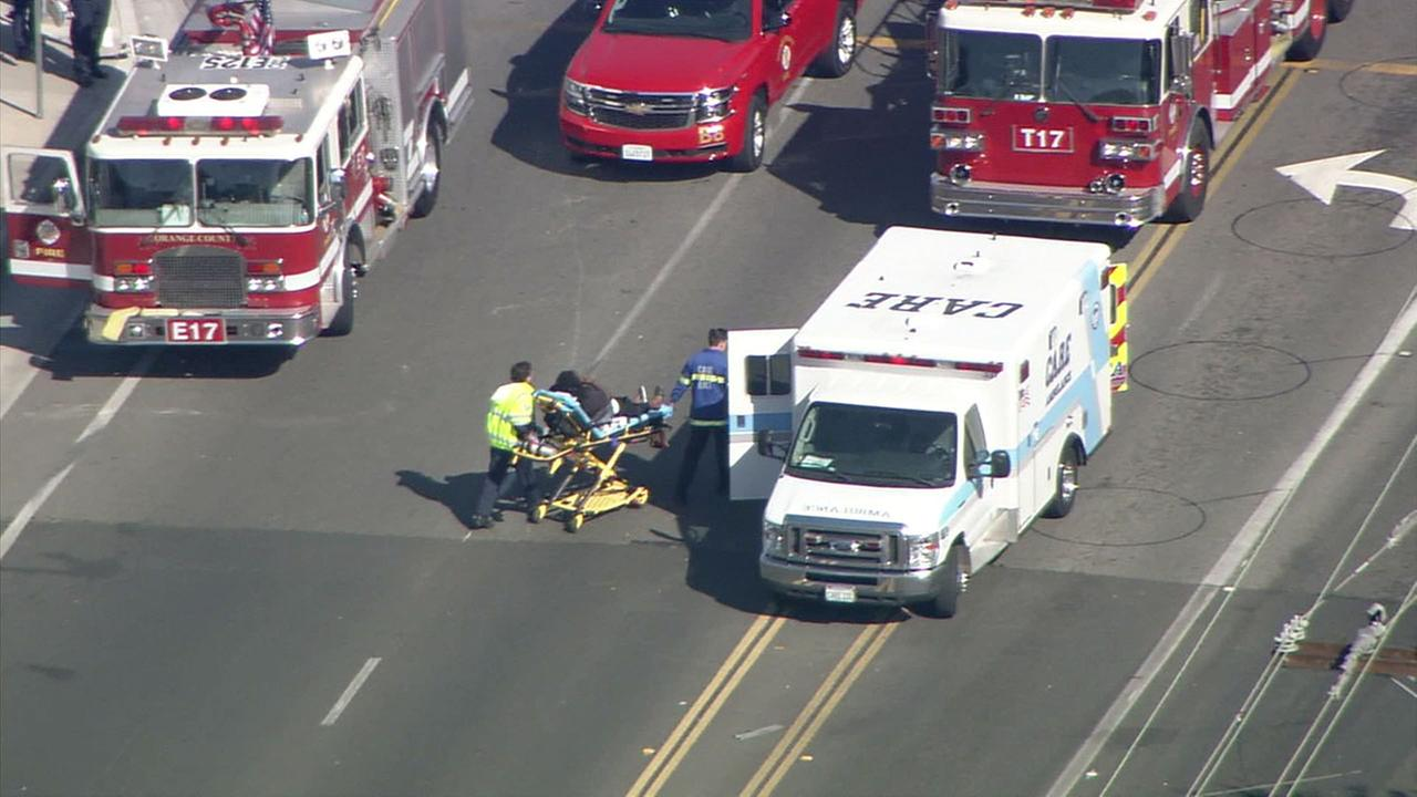 Paramedics treated at least four injured pedestrians after a vehicle collision in Los Alamitos.
