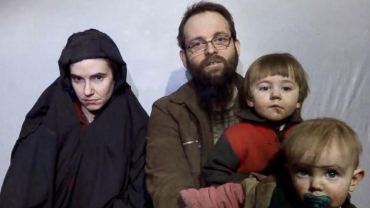 A still image from a video posted by the Taliban on social media, Dec. 19, 2016, shows American Caitlan Coleman next to her Canadian husband Joshua Boyle and their two sons.