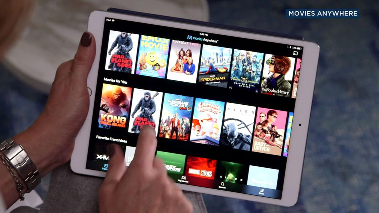 A woman swipes through the Movies Anywhere app on a tablet.