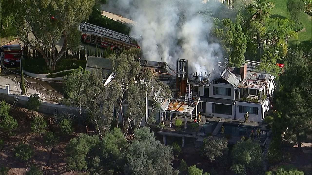 A house under construction in Bel AIr caught fire on Tuesday, Oct. 17, 2017.