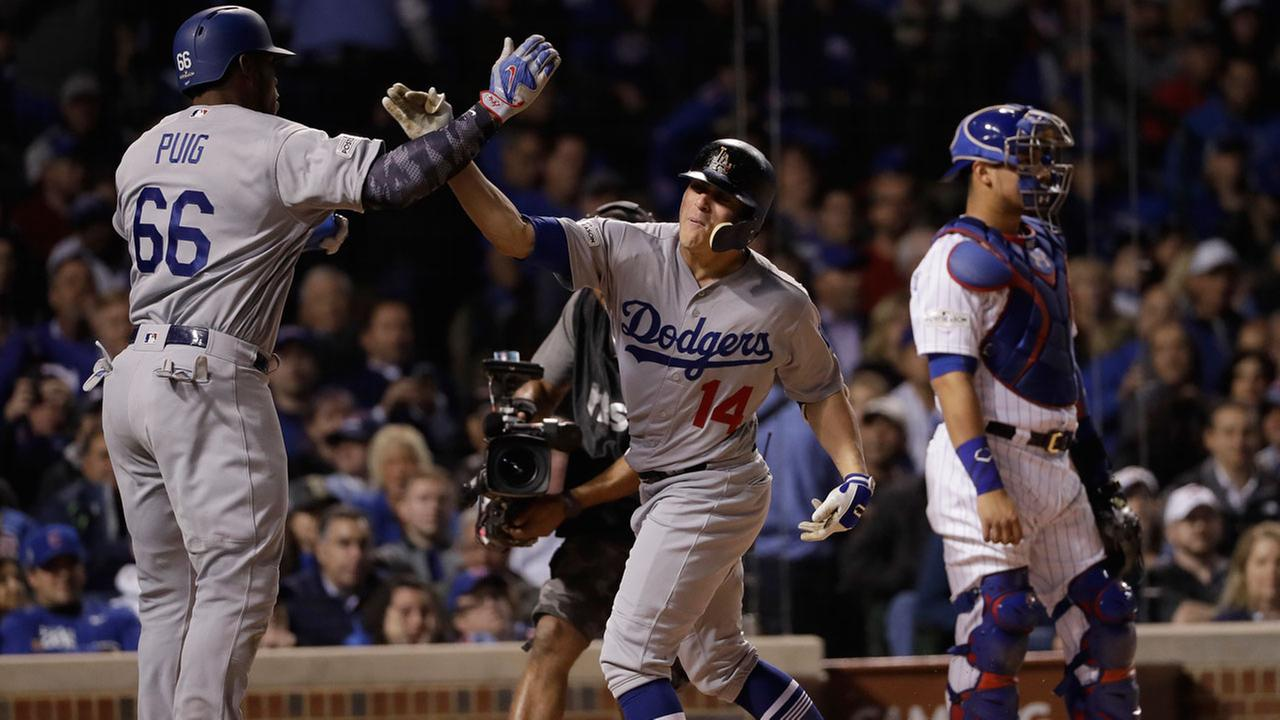 Los Angeles Dodgers Enrique Hernandez celebrates his grand slam with Yasiel Puig during Game 5 of baseballs NLCS against the Chicago Cubs, Thursday, Oct. 19, 2017, in Chicago.