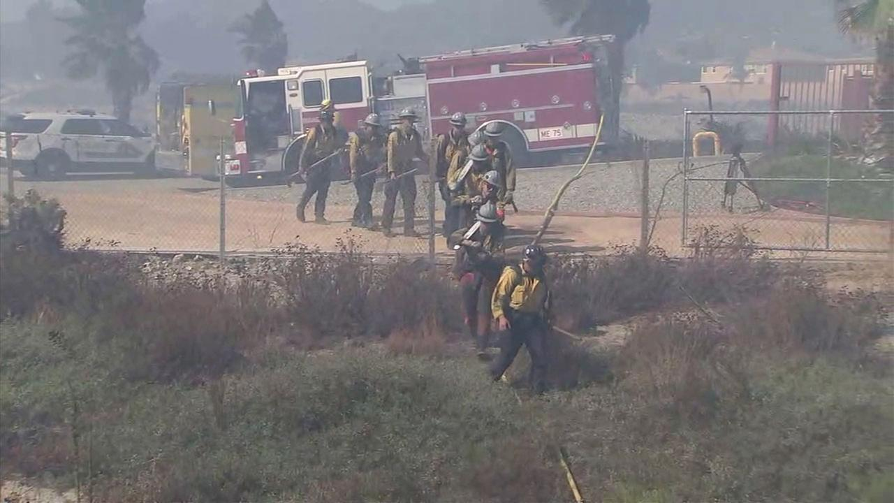 Firefighters responded quickly to a brush fire that broke out near the 15 and 210 freeways in Rancho Cucamonga Tuesday morning.
