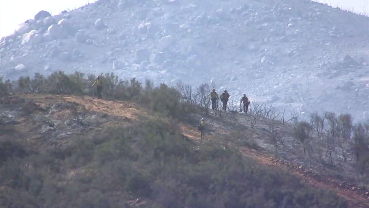 Charred brush is seen from the Wildomar Fire, which burned 850 acres in western Riverside County.