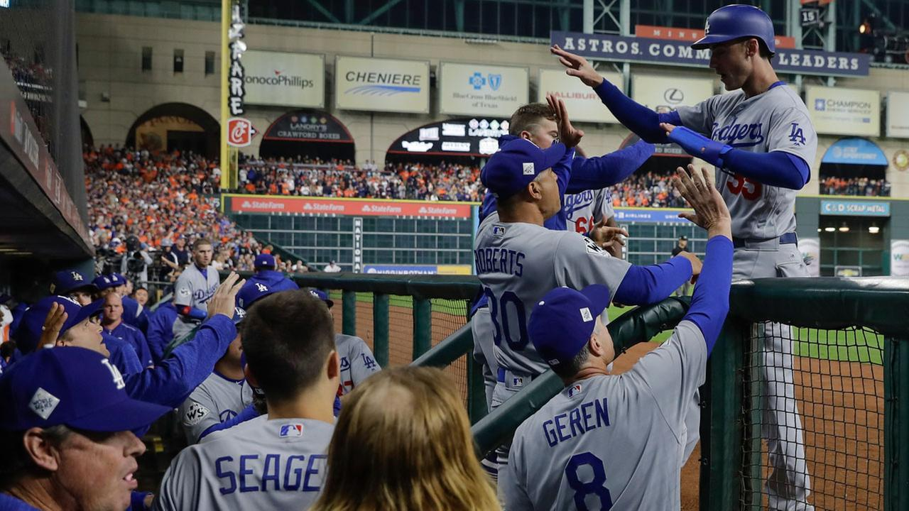 Los Angeles Dodgers Cody Bellinger is congratulated after scoring on a hit by Logan Forsythe during Game 4 of baseballs World Series against the Houston Astros.