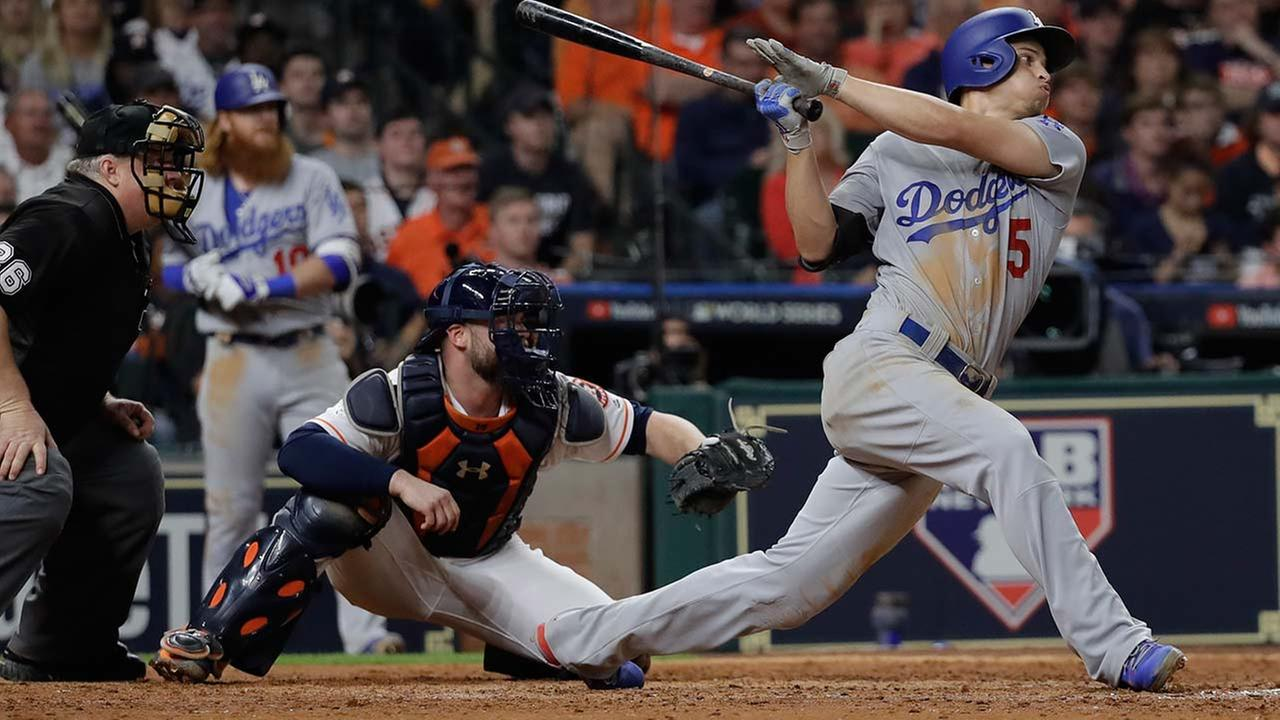 Los Angeles Dodgers Corey Seager hits an RBI double during the eighth inning of Game 5 of baseballs World Series against the Houston Astros Sunday, Oct. 29, 2017, in Houston.