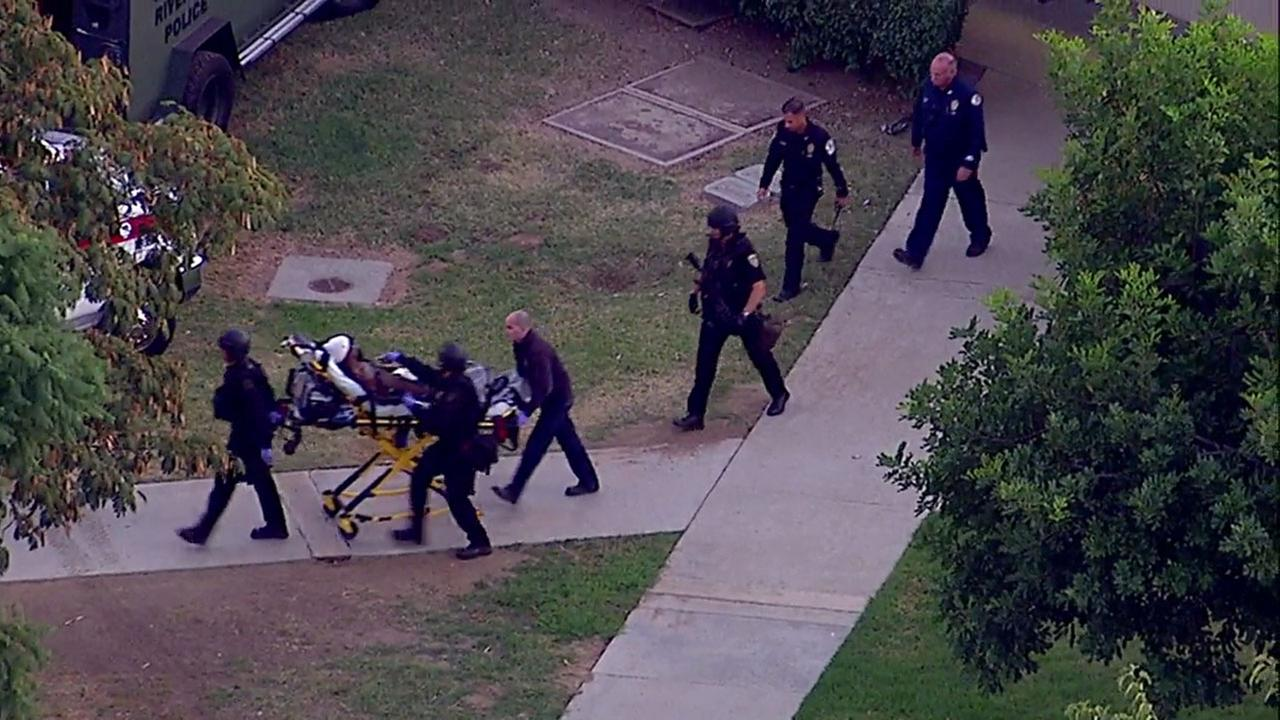 Authorities wheeled out a man on a stretcher after an hourslong barricade at a Riverside elementary school on Tuesday, Oct. 31, 2017.