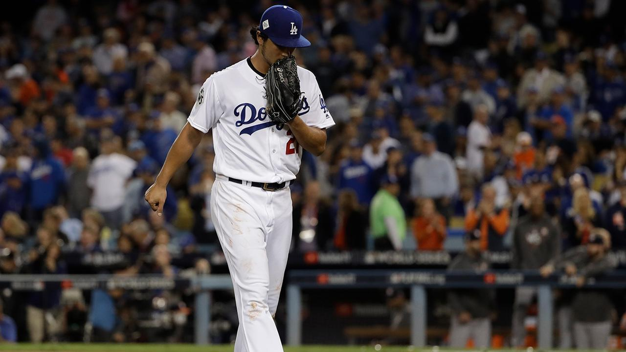 Dodgers starting pitcher Yu Darvish reacts after being taken out of the game during the second inning of Game 7 of the World Series against the Astros Wednesday, Nov. 1, 2017.
