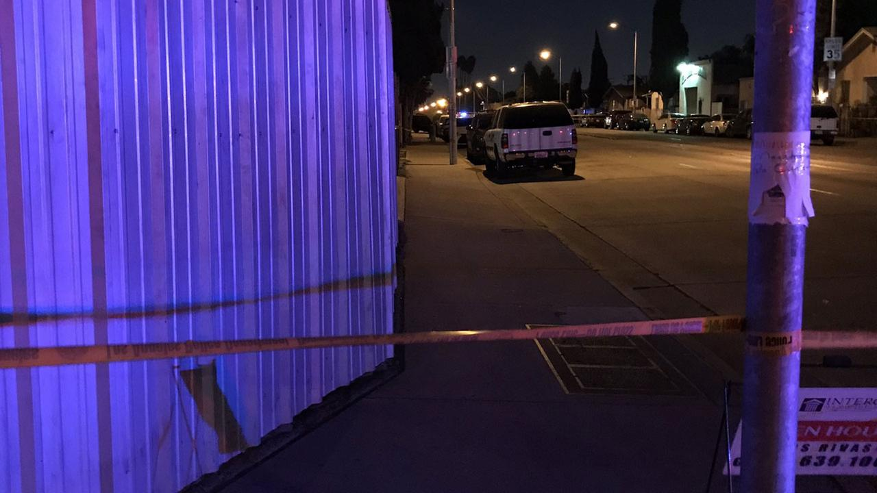 Authorities cordoned off an area in South Los Angeles after a man was found shot to death after a car crash on Saturday, Nov. 4, 2017.
