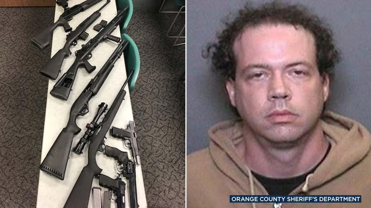 David Kenneth Smith, 40, was arrested on Nov. 4. Nine loaded guns were confiscated when he was taken into custody, officials said.