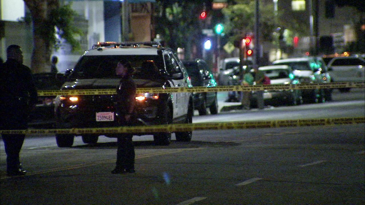 Police at the scene of a shooting that left three people wounded on Wednesday, Nov. 8, 2017.