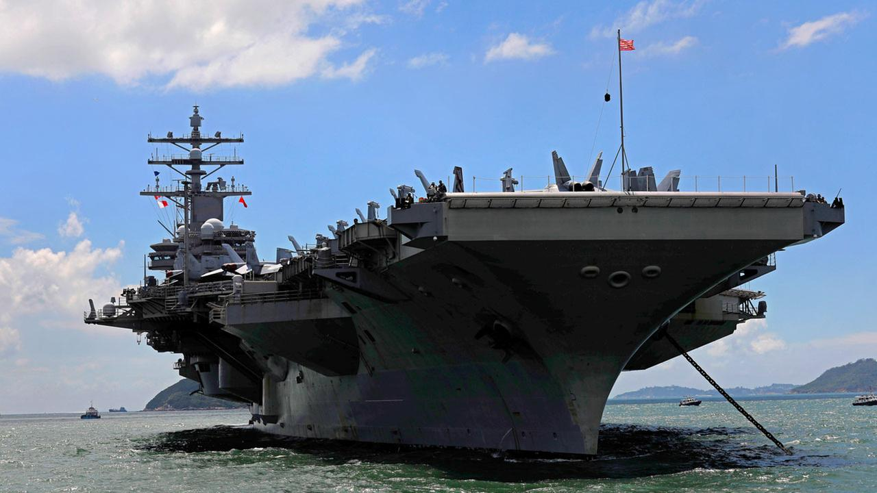In this Monday, Oct. 2, 2017, file photo, the USS Ronald Reagan aircraft carrier arrives in Hong Kong.