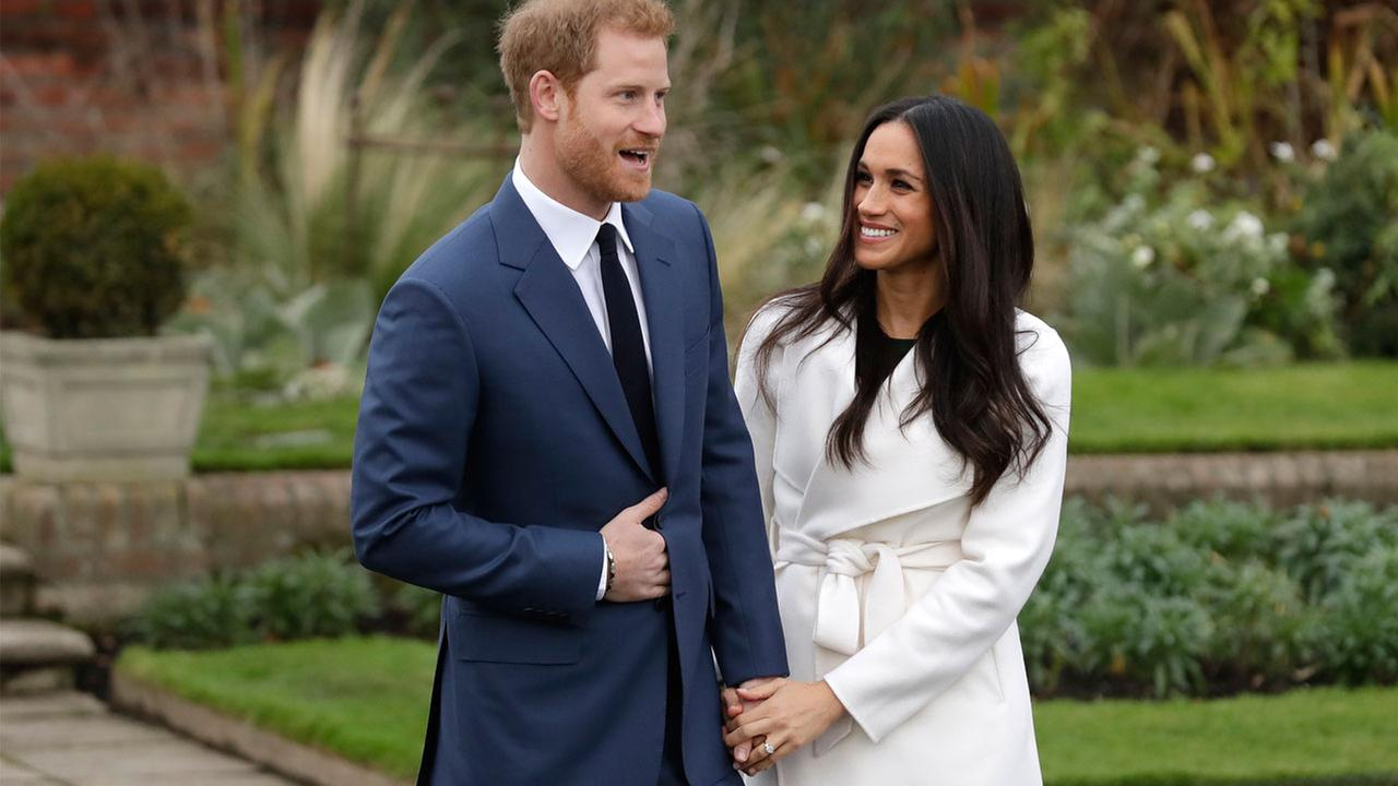 Britains Prince Harry and his fiancee Meghan Markle pose for photographers during a photocall in the grounds of Kensington Palace in London, Monday Nov. 27, 2017.