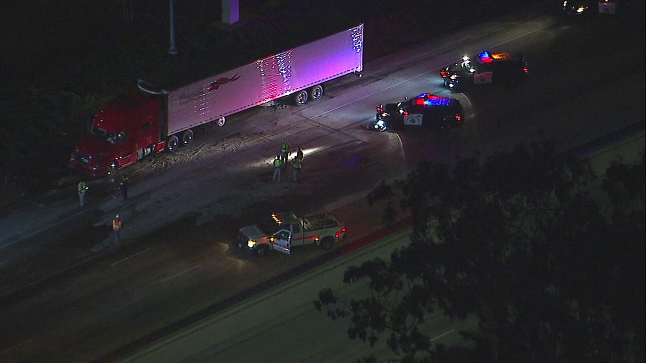 A semi-truck crashed on the 710 Freeway in East L.A. on Friday, resulting in a fuel spill and the closure of all northbound lanes of the Long Beach Freeway near the 60 Freeway.