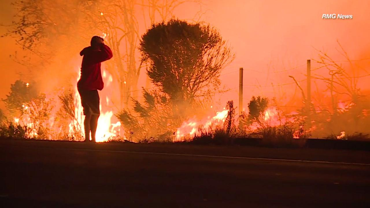 A man appears to panic as a wild rabbit got too close to flames from the Thomas Fire along Highway 1 in La Conchita on Wednesday, Dec. 6, 2017.