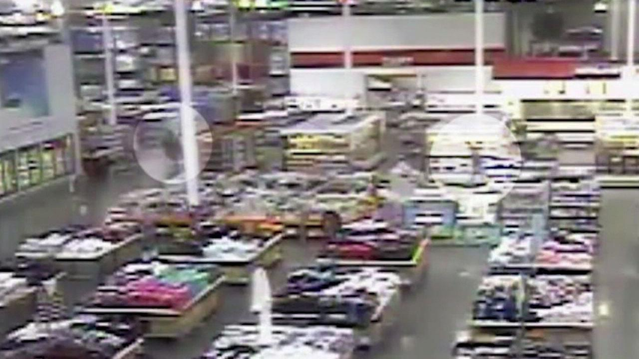 Surveillance video shows the gunman and the off-duty Kansas City officer inside a Costco during a tense situation.