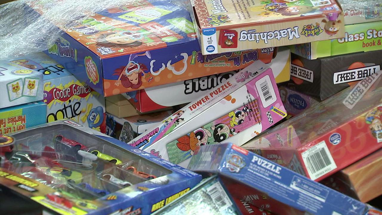 Toys donated by thousands of people during the Spark of Love toy drive were handed out to families in need in Ontario on Saturday, Dec. 16, 2017.
