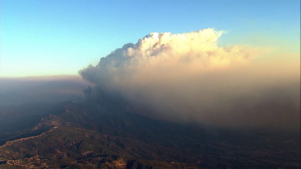 A large, thick plume of smoke erupted from the Thomas Fire as it charred dry brush in steep terrain in Santa Barbara County on Saturday, Dec. 16, 2017.