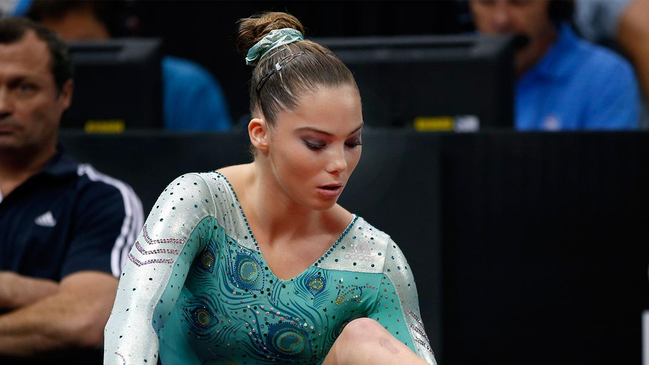 McKayla Maroney rubs her ankle prior to competition in the U.S. womens national gymnastics championships in Hartford, Conn. Thursday, Aug. 15, 2013.