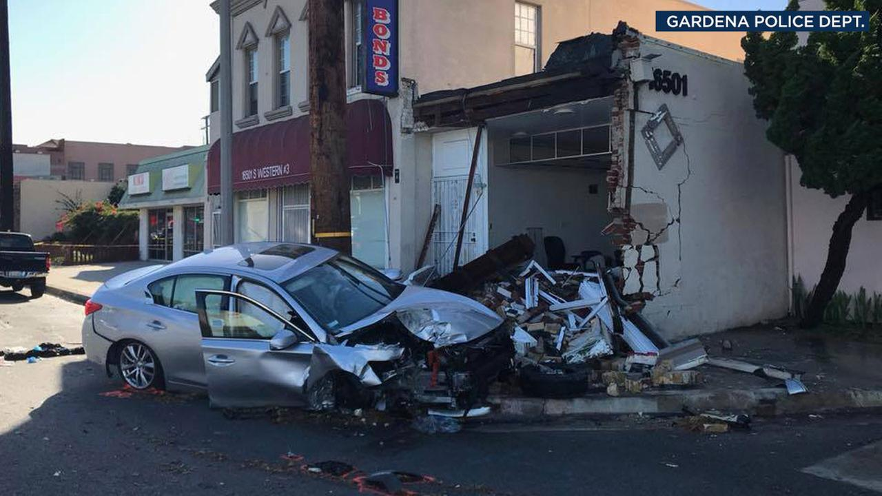 A mangled Infiniti sedan is shown after the driver got into a crash with a motorcyclist, who later died, in Gardena on Thursday, Dec. 21, 2017.