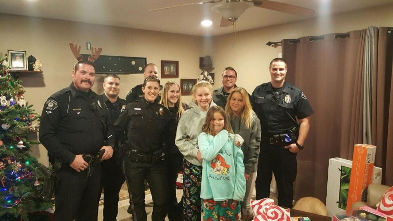 Simi Valley police officers took a photo with a family of three after their Christmas gifts and other items in the home were stolen by a burglar on Thursday, Dec. 21, 2017.