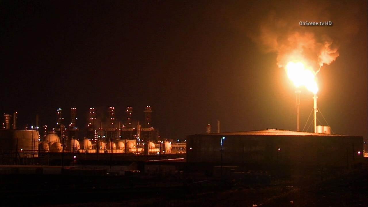 Flames are seen at the ExxonMobil refinery in Torrance on Tuesday, Aug. 26, 2014.