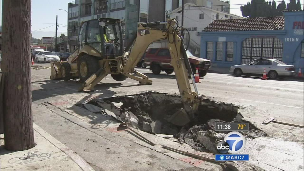 Crews clean up following a water-main break in Echo Park on Tuesday, Aug. 26, 2014.