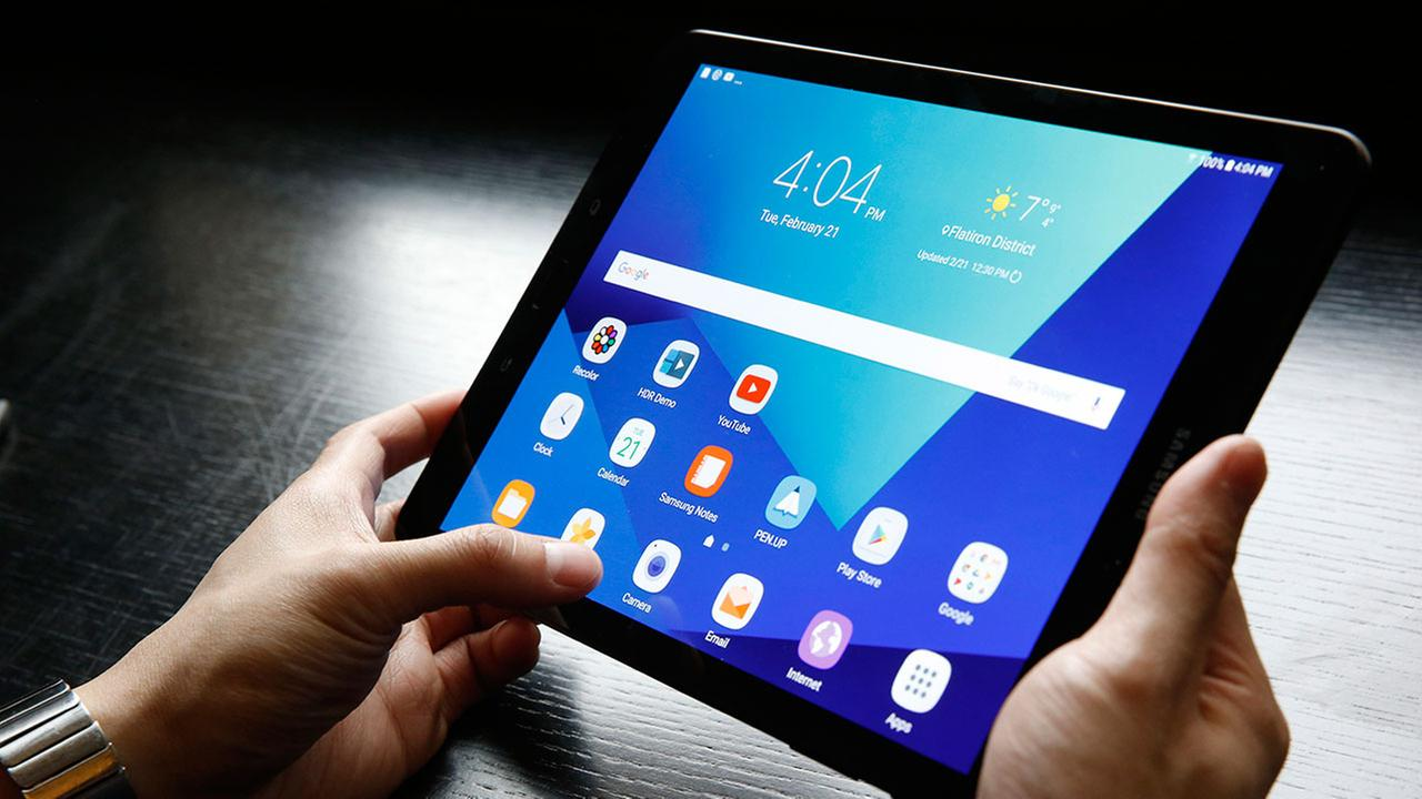 This file image shows a person using a Samsung Tab S3 Android tablet device.