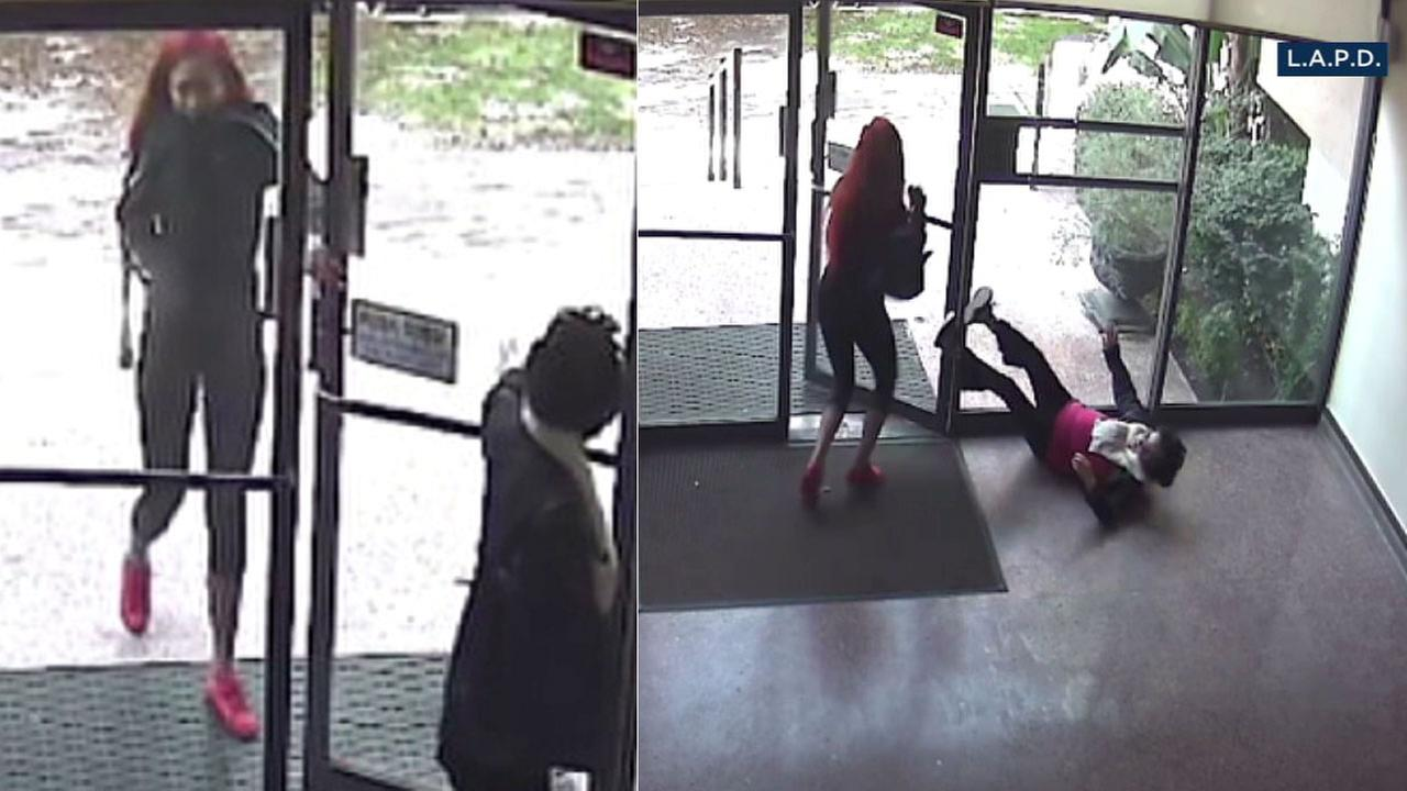 Surveillance video shows a woman following an older victim into a Koreatown apartment building, grabbing her purse and pushing her to the ground.