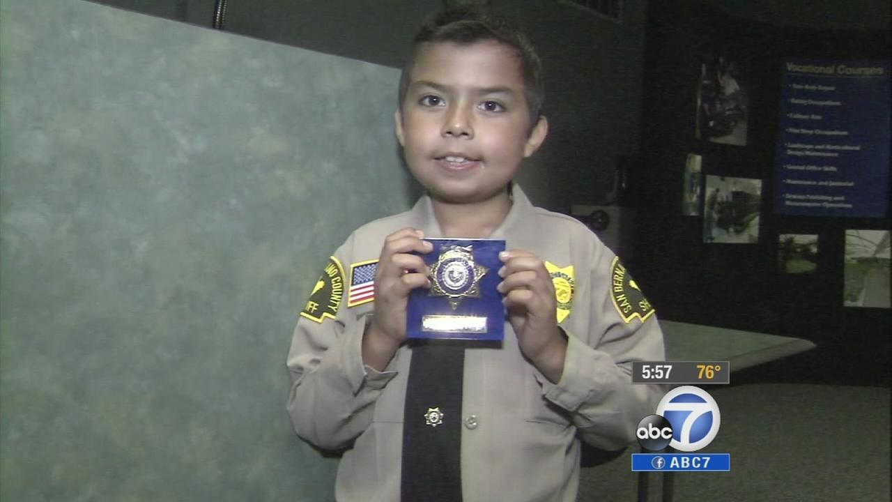 Odie Garcia, who has been battling cancer, was sworn in as an honorary San Bernardino County sheriffs deputy for his ninth birthday Tuesday, Sept. 2, 2014.