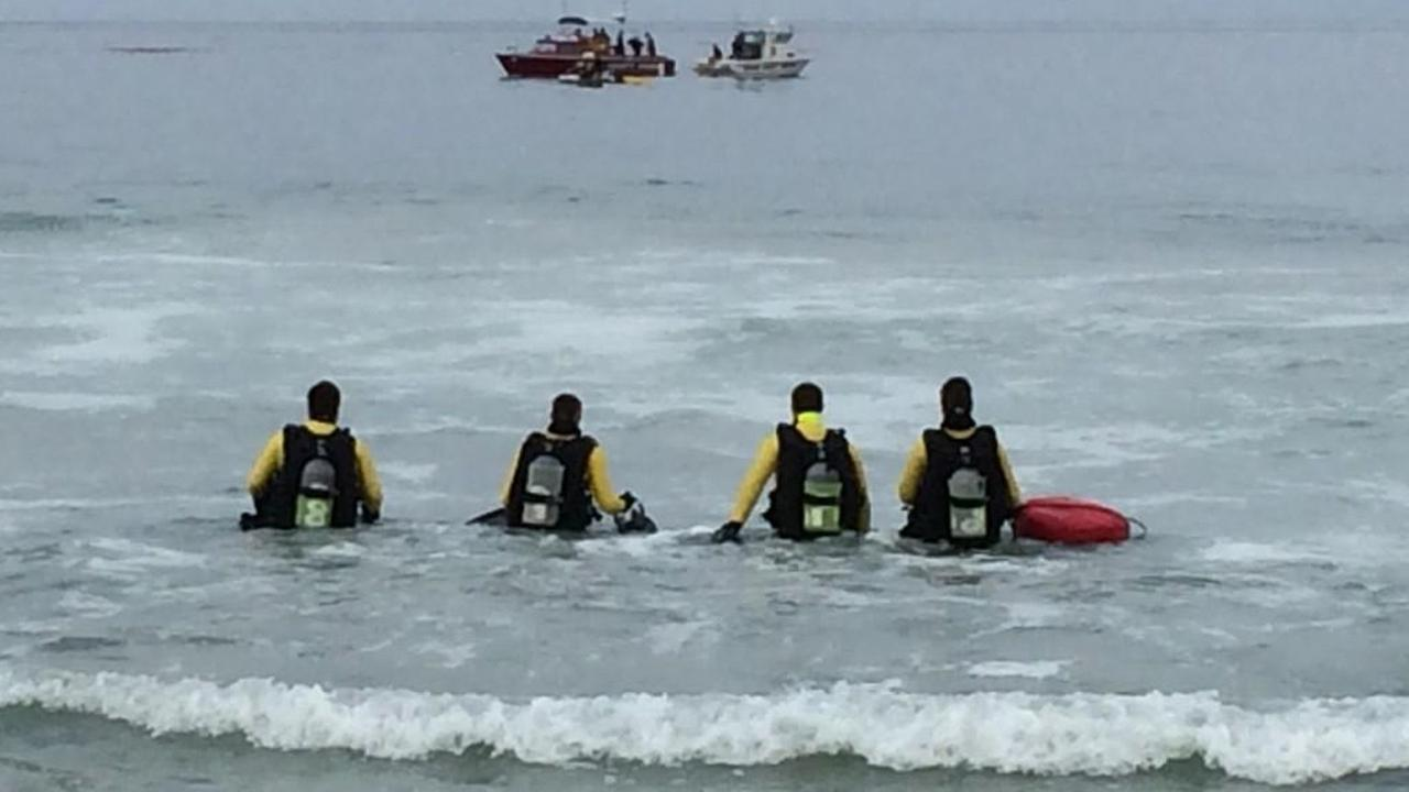 A dive team deployed off the coast of Salt Creek Beach to search for a missing swimmer on Wednesday, Sept. 3, 2014.