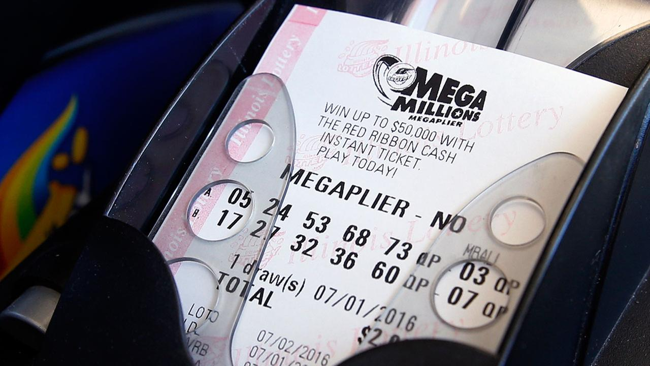 A Mega Millions lottery ticket is printed out of a lottery machine at a convenience store in Chicago, Friday, July 1, 2016.