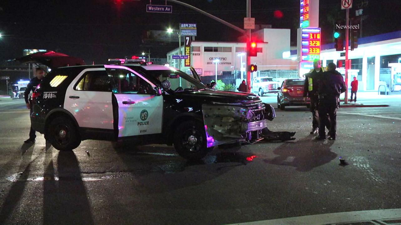 An LAPD patrol vehicle is seen damaged after a crash in the Koreatown area on Friday, Jan. 12, 2018.