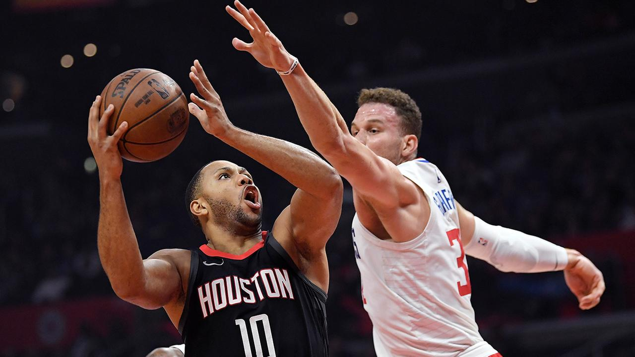 Rockets guard Eric Gordon, left, shoots as Clippers forward Blake Griffin defends during the first half of an NBA basketball game, Monday, Jan. 15, 2018, in Los Angeles.