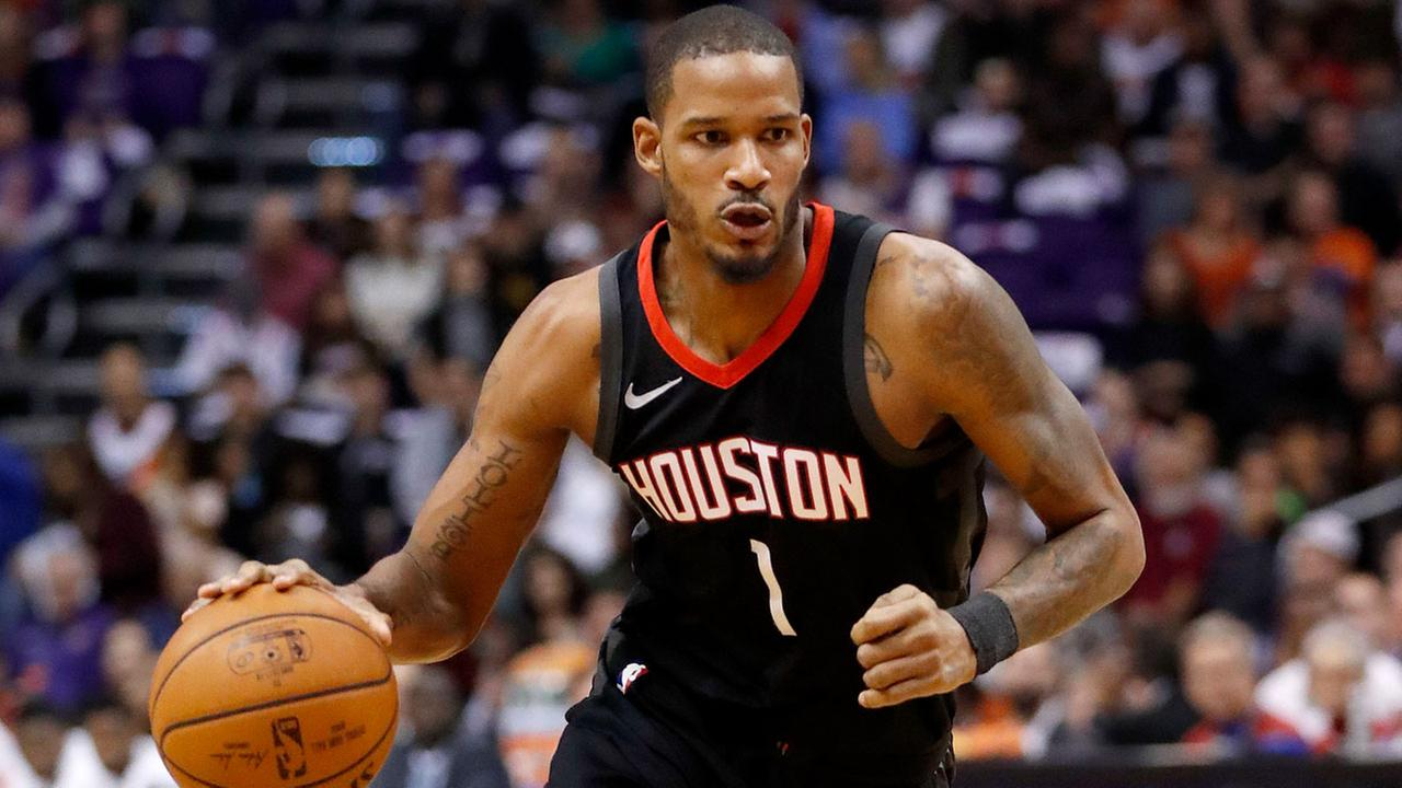 In this Jan. 12, 2018, photo, Houston Rockets forward Trevor Ariza (1) drives against the Phoenix Suns during the first half of an NBA basketball game in Phoenix.
