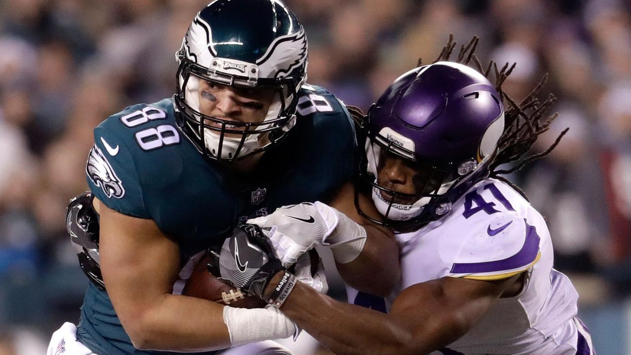 Philadelphia Eagles Trey Burton catches a pass in front of Minnesota Vikings Anthony Harris during the NFL football NFC championship game Sunday, Jan. 21, 2018, in Philadelphia.