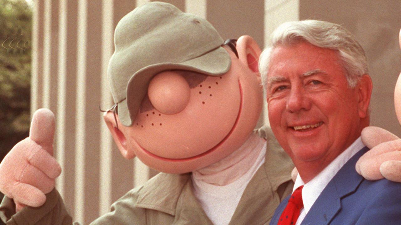 Mort Walker, who created the comic strip Beetle Bailey in 1950, poses with Bailey during ceremonies at the Pentagon in Washington in this June 15, 1990 file photo.