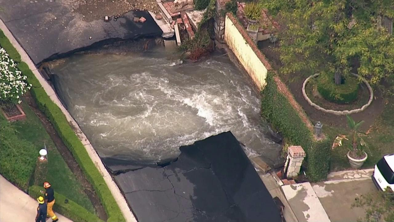 A water-main break in Encino flooded streets and backyards Monday, Sept. 9, 2014.