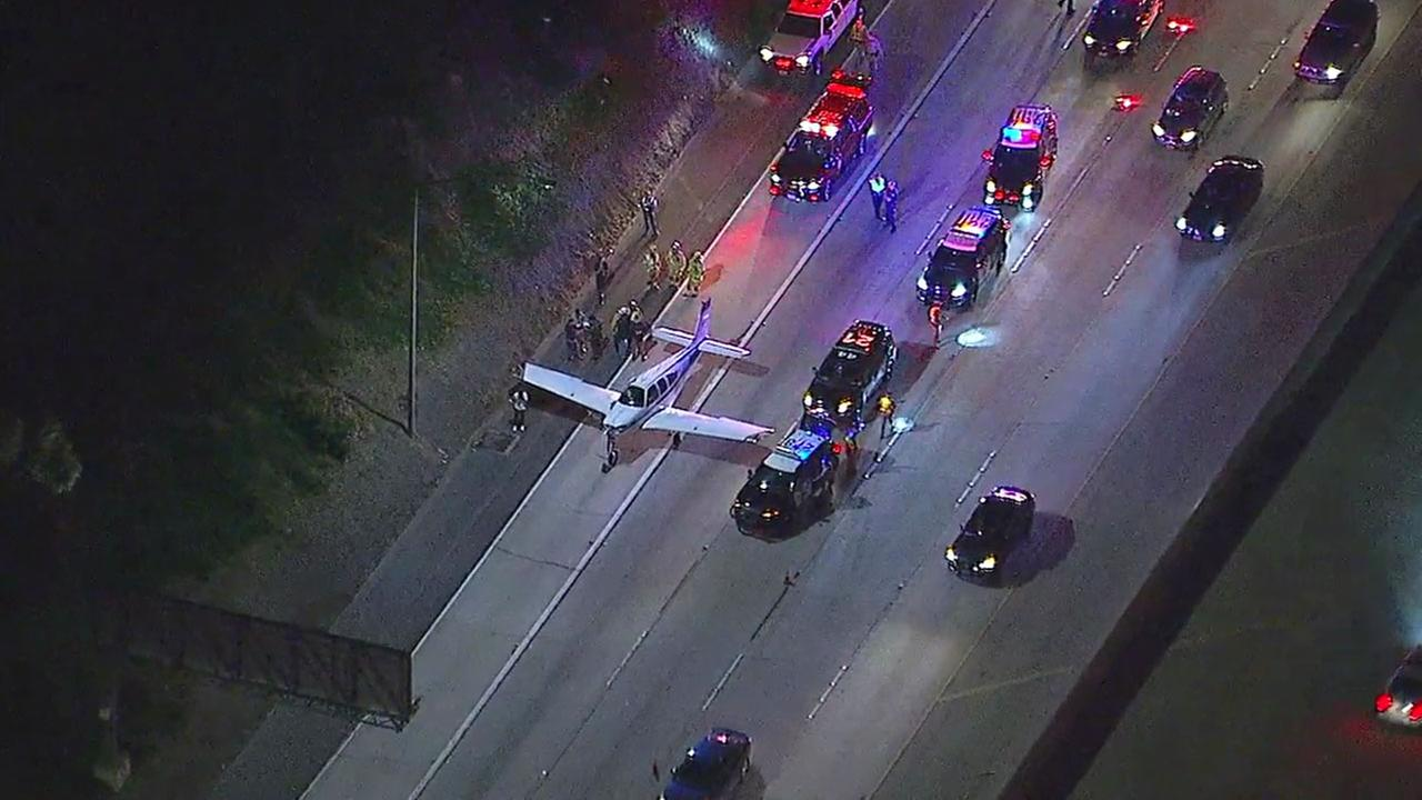 Authorities control traffic on the northbound 55 Freeway in Costa Mesa after a small plane made an emergency landing in some of the lanes on Sunday, Jan. 28, 2018.