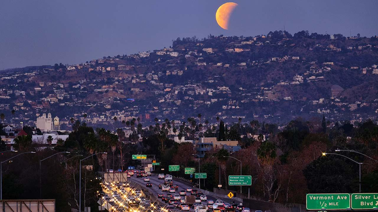 A super blue blood moon is seen setting behind the Hollywood hills in Los Angeles on Wednesday Jan. 31, 2018.