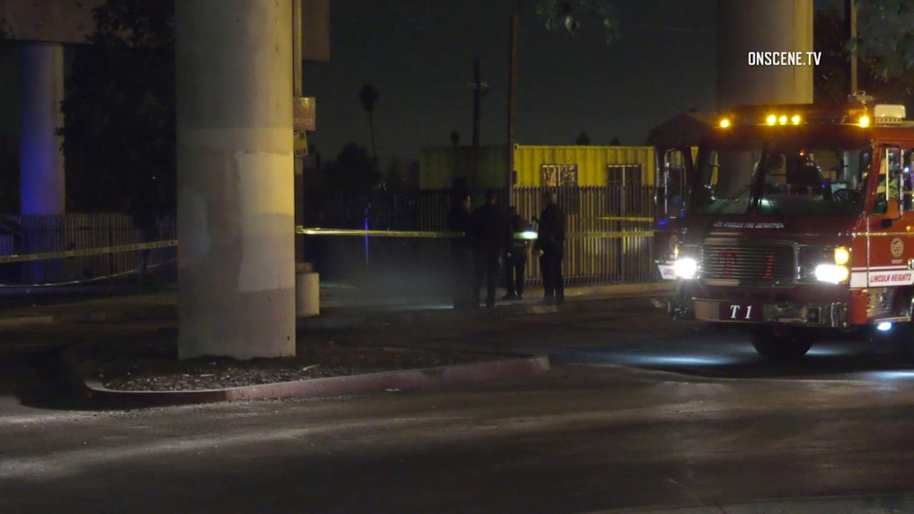 Authorities investigate a scene in Cypress Park where human remains were found set on fire on Thursday, Feb. 1, 2018.